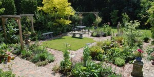 Graphic areas of grass and planting create paths and garden spaces